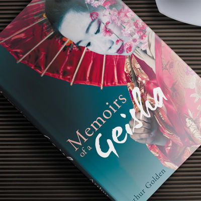 Memoirs of a Geisha Book Jacket Design Displayed on a Book on a Table